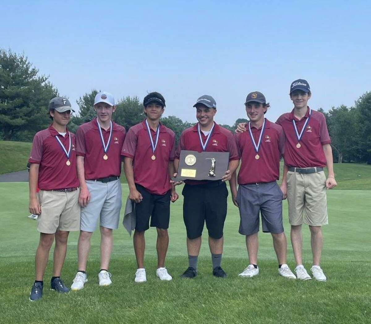 St. Joseph golf team members Andrew Flynn, Colin Firda, Luke Fortin, Billy Lesko, Anthony Jacozzi and Robbie Sluga stand with the CIAC Division III championship plaque.