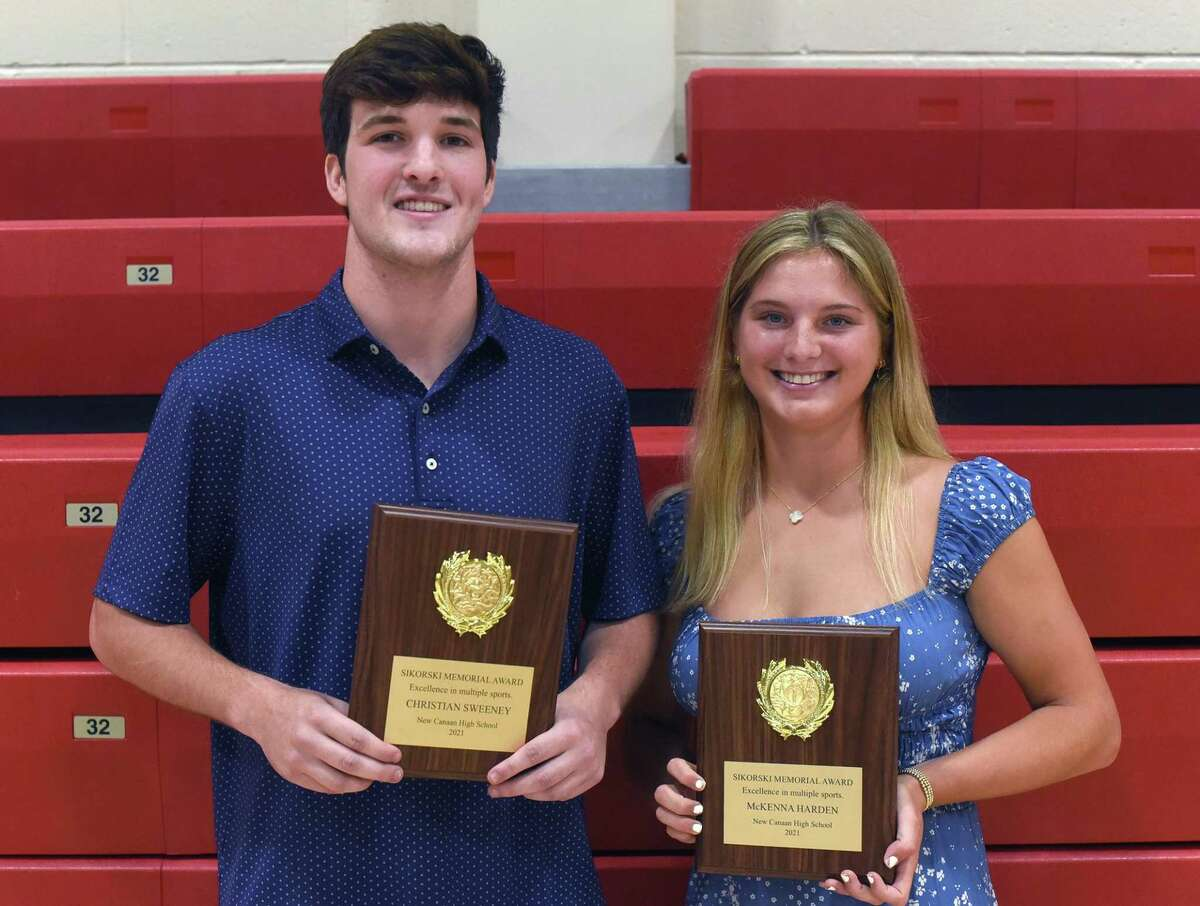 New Canaan's Christian Sweeney and McKenna Harden received this year's Sikorski Memorial Award during a ceremony at NCHS on Monday.