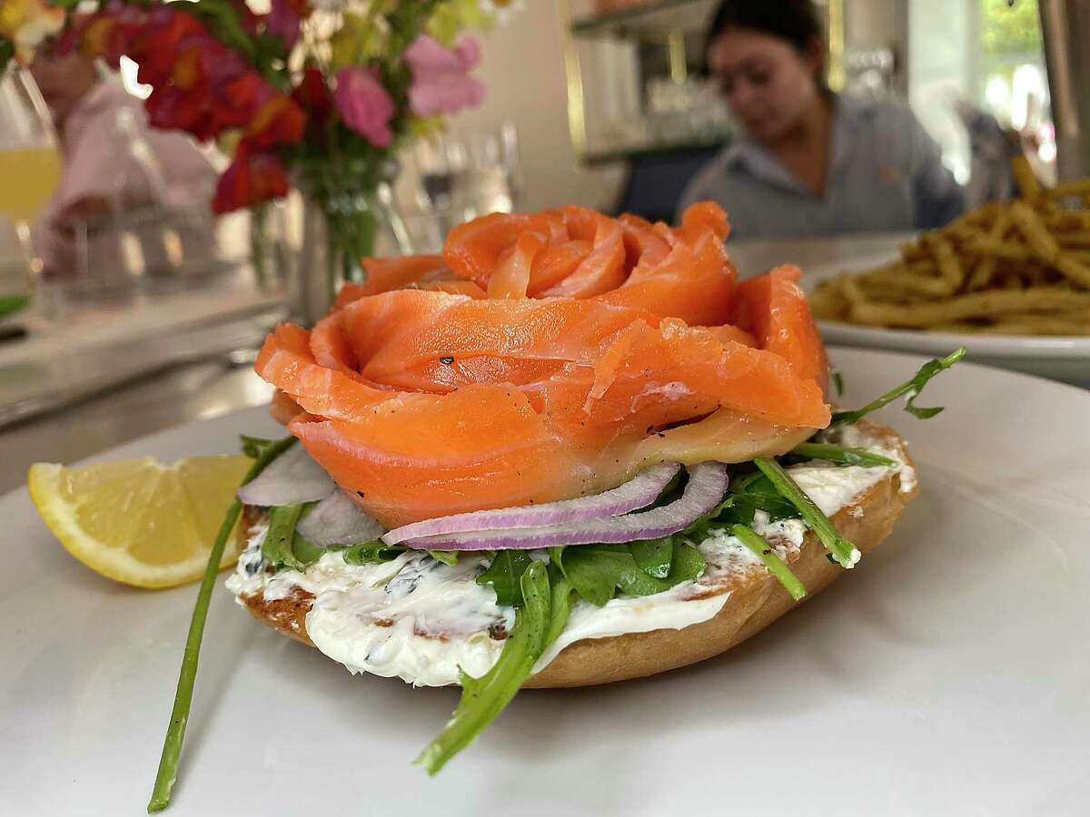 A bagel with lox includes cured salmon, Boursin cheese, onion and greens at Little Em's Oyster Bar.