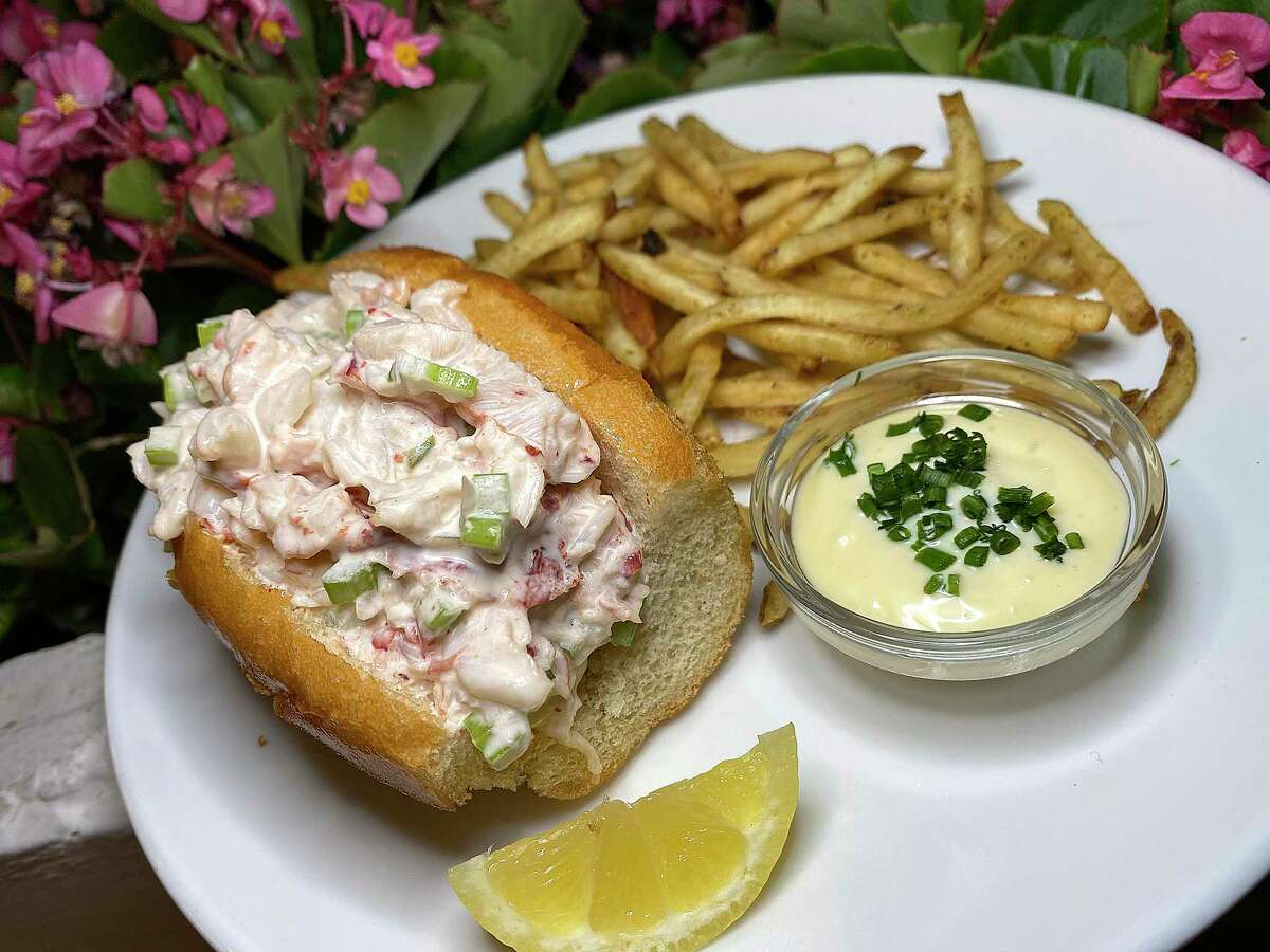 A lobster roll comes with tarragon aioli and shoestring fries at Little Em's Oyster Bar.