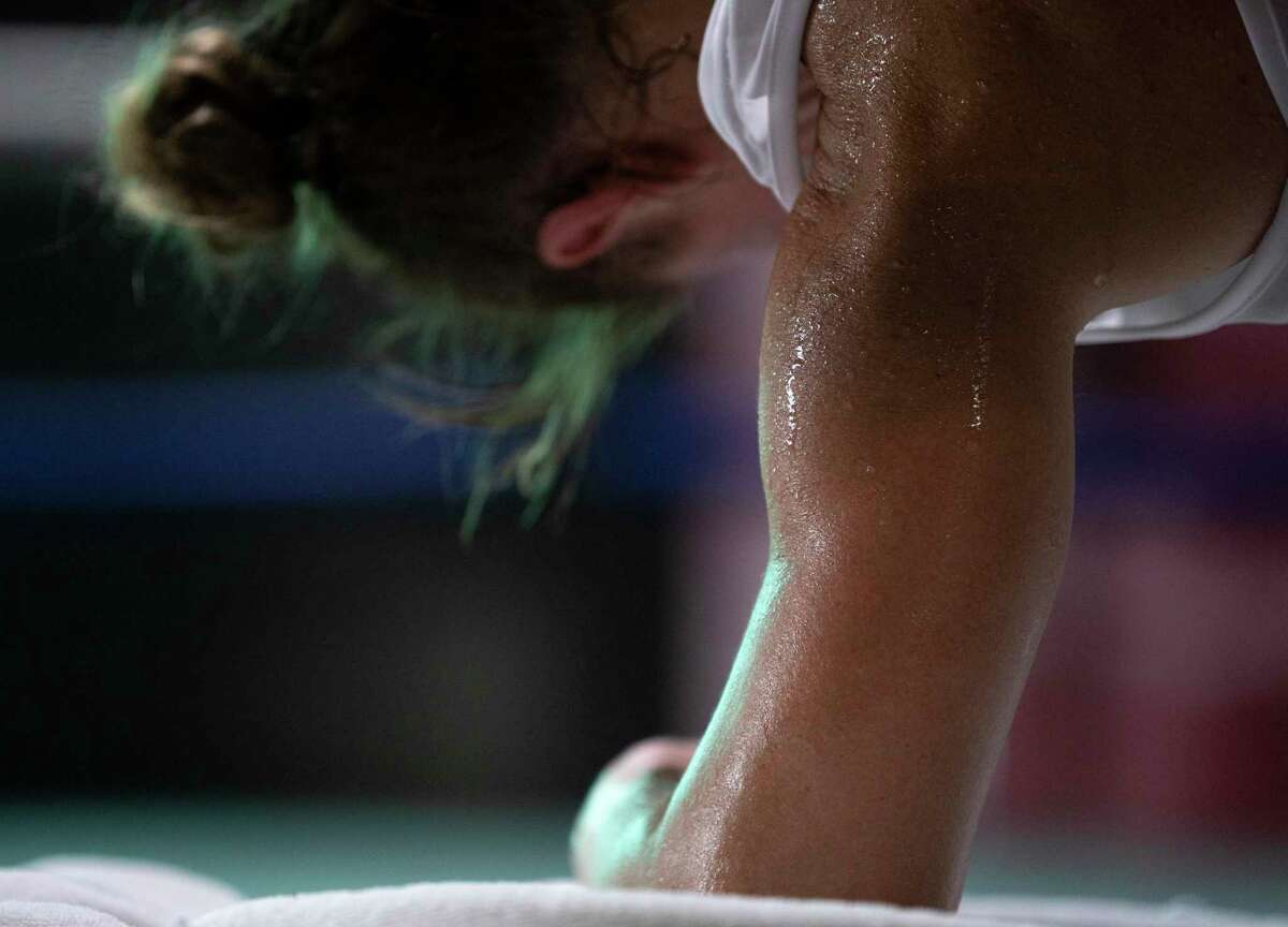 Sweat drips down as Olympic boxer Ginny Fuchs is working out in her final Houston-area workout before heading to final prep for Tokyo Olympics Saturday, May 29, at Baby Bull Gym in Houston.