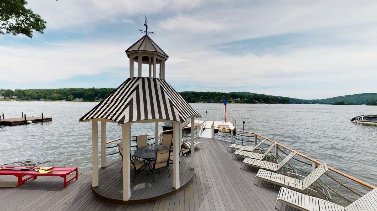 The home on 84 Forty Acre Mountain Road in Danbury, Conn,. has 110 feet of direct lakefront, as well as its own deep-water dock and drive-up jet ski ports.
