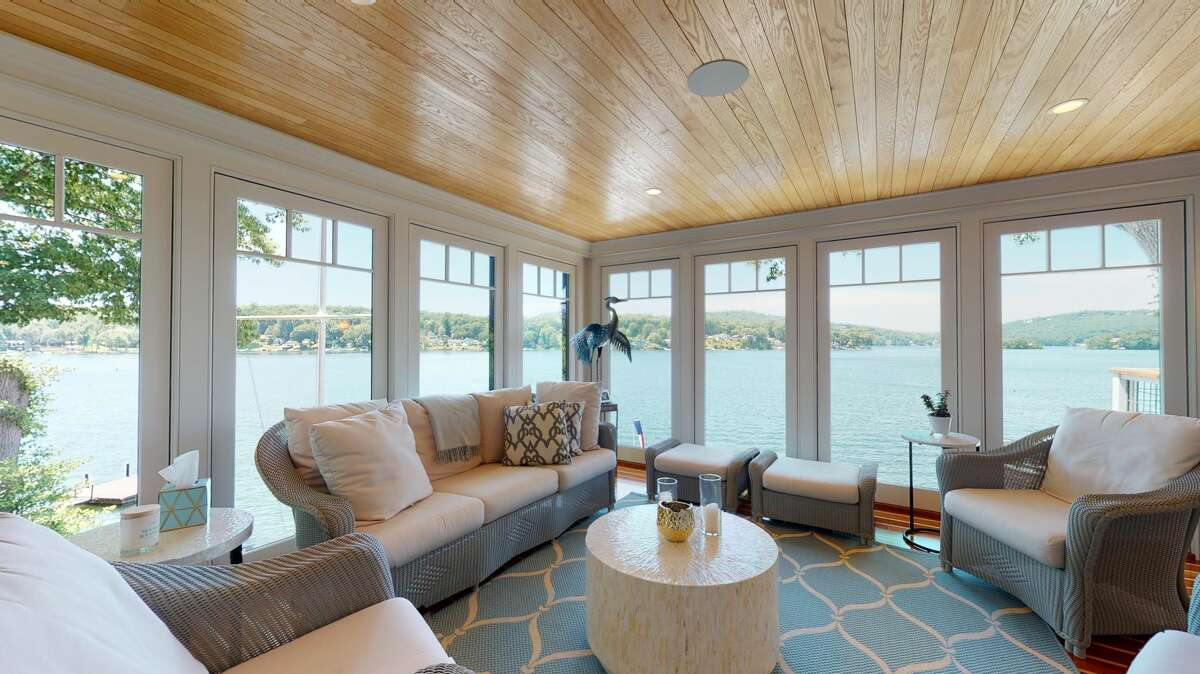 The home on 84 Forty Acre Mountain Road in Danbury, Conn,. has a lakefront sun room that has direct views of Candlewood Lake. Read more