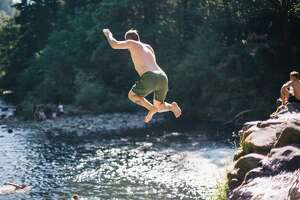 In the Pacific Northwest, cliff jumping is a favorite way to beat the summer heart for the locals.
