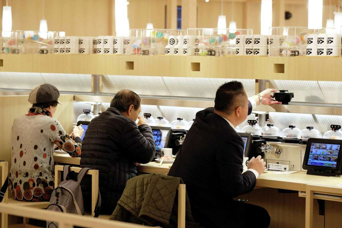 Customers dine at the flagship Kura Sushi location in Tokyo.