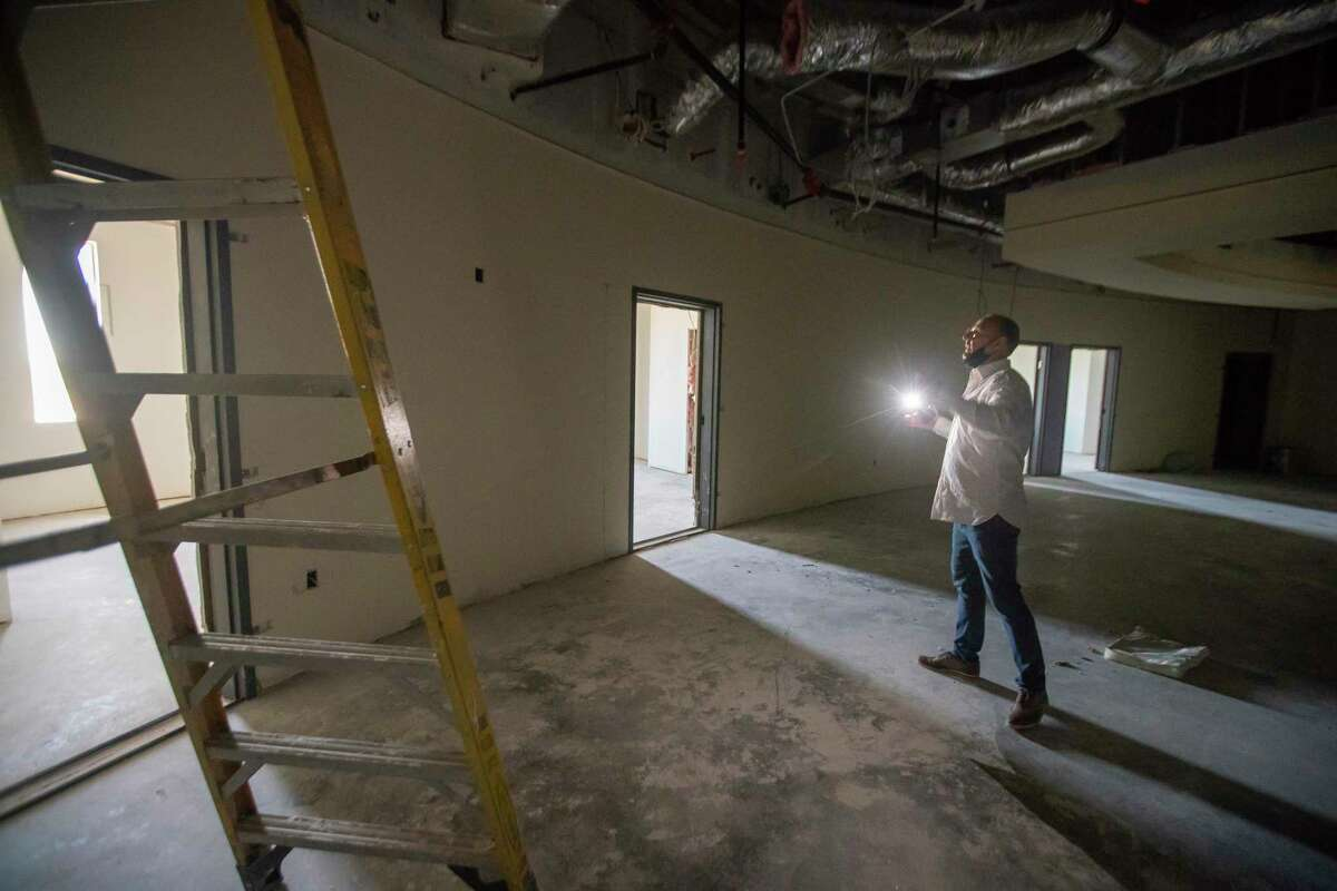 Kevin Munz, chairman of the board of governors for Sacred Oak Medical Center, walks through a new unit under construction at the Clear Lake mental health hospital. The unit would have added 24 beds to the hospital's capacity, but construction was halted after the state yanked its license last year.