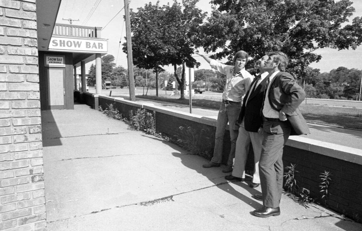 Ann Arbor economic consultant Franz Mogdis, show above at right along with architect Gene Hopkins (left) and construction supervisors Dick Marrone discuss the renovation of the Dunham House. The photo was published in the News Advocate on June 25, 1981. (Manistee County Historical Museum photo)