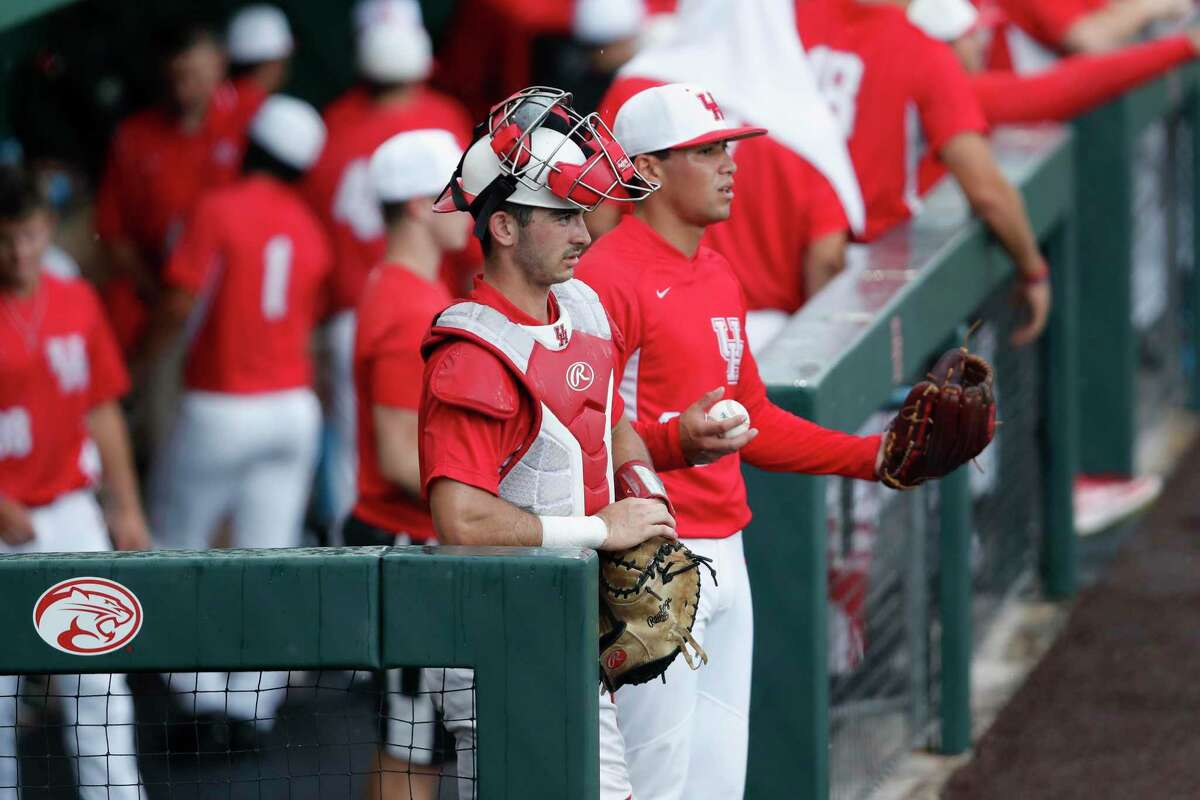 Houston Cougar catcher Connor Wong (10) and pitcher Fred Villarreal (23) wait in the dugout during the 2017 NCAA Houston Regional baseball game between Houston and Baylor June 3, 2017 in Houston.