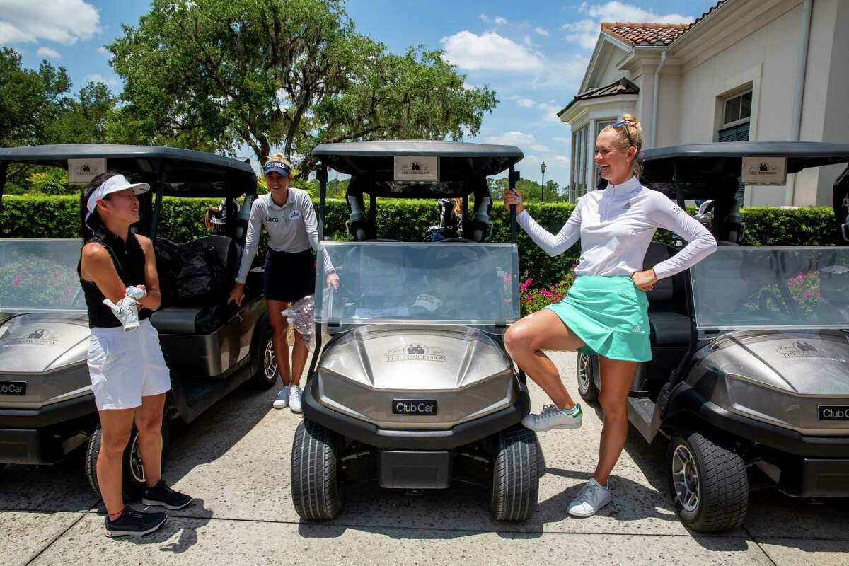 LPGA pros Jessica Korda (right)and Nelly Korda (middle) share a laugh with 14-year-old Hudsonville resident Sophia Howard (left) after playing a round of golf together at Concession Golf Club in Bradenton, Fla. (Photo provided/Emby Taylor Photography)