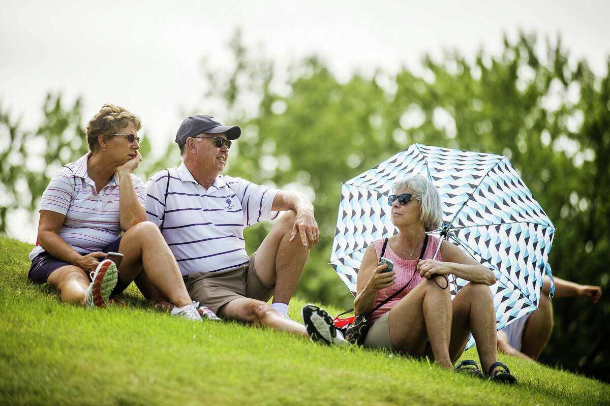 Fans watch the first round of play in the inaugural Dow Great Lakes Bay Invitational on Wednesday, July 17, 2019 at Midland Country Club. (Katy Kildee/kkildee@mdn.net)