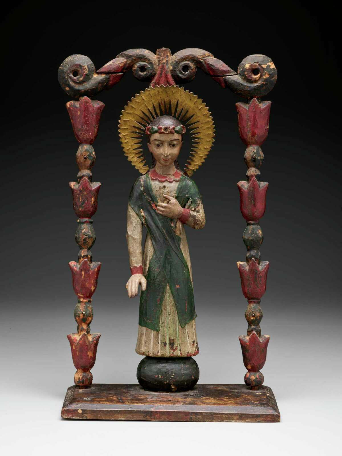 """Saint Rosalia of Palermo carving attributed to José Rafael Aragón from """"Devoted: Art and Spirituality in Mexico and New Mexico"""" at Dallas Museum of Art."""