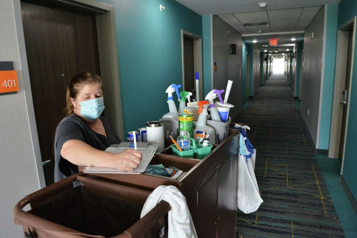 Ramona Ward of the housekeeping staff at the LaQuinta Inn, 11006 N I-35, does paperwork as the area's lodging sector begins to rebound from the pandemic.