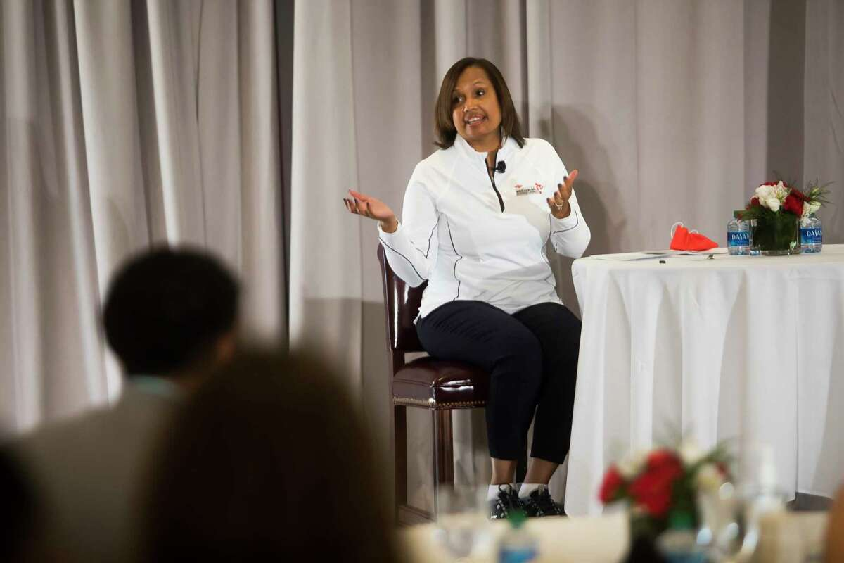 Karen S. Carter, Dow's chief inclusion officer and chief human resources officer, speaks during a Media Day event for the Dow Great Lakes Bay Invitational Monday, June 14 at the Midland Country Club. (Katy Kildee/kkildee@mdn.net)