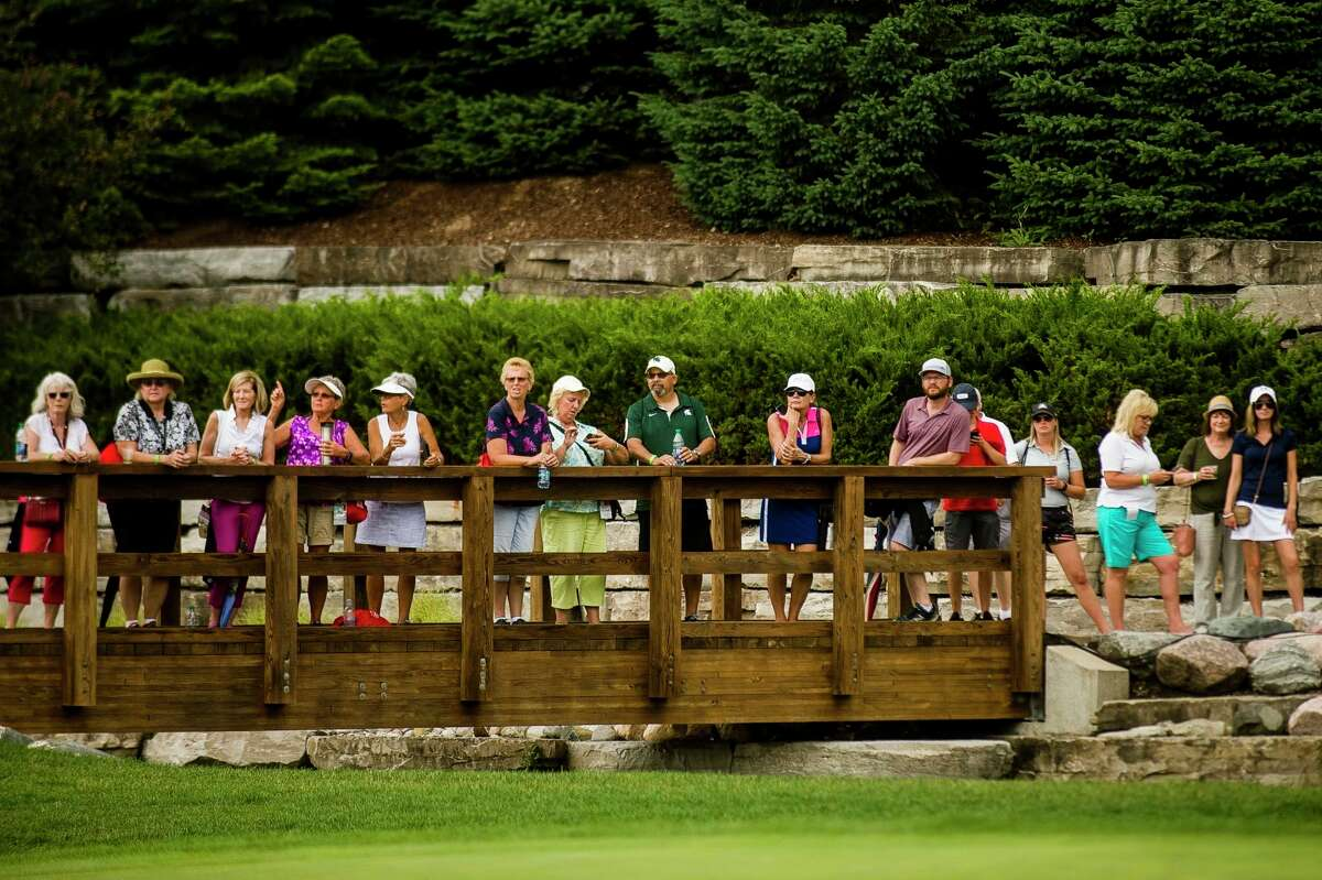 Fans watch the closing ceremony of the Dow Great Lakes Bay Invitational on Saturday, July 20, 2019 at Midland Country Club. (Katy Kildee/kkildee@mdn.net)