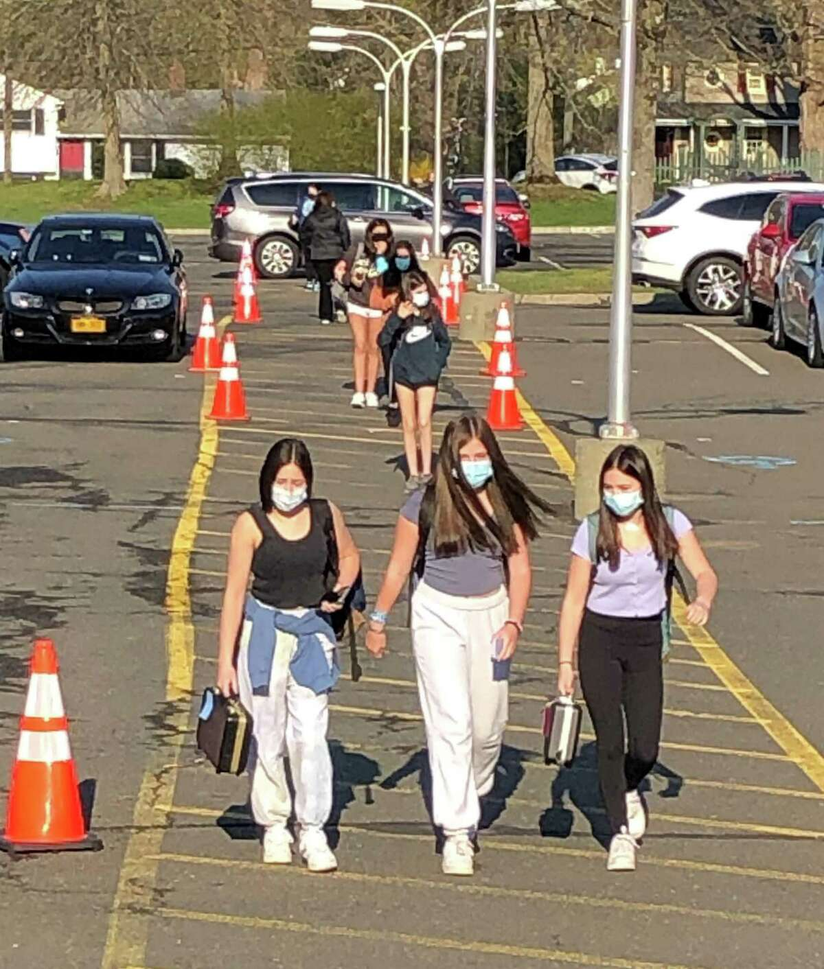 Ridgefield students will have to continue wearing masks while inside school buildings or buses next year, district officials announced Thursday.