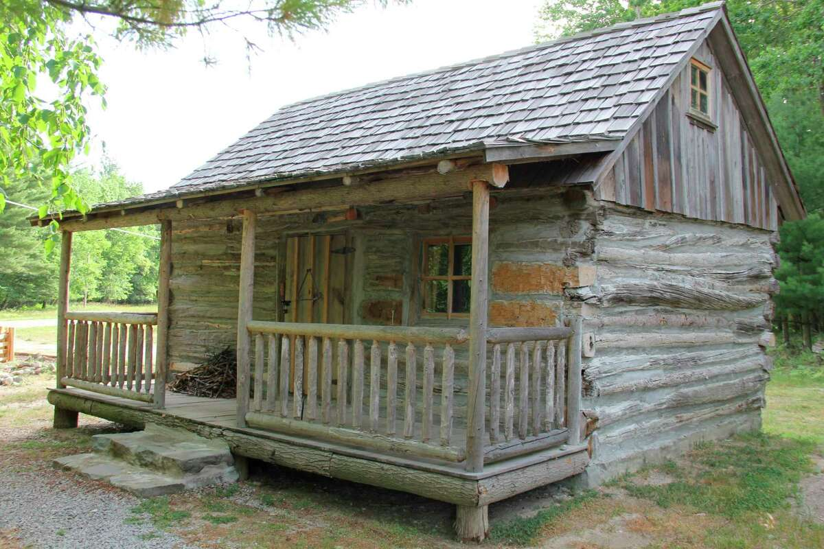 The log cabin at the Port Austin History Center will be open this weekend with various activities available. The center has been open since the beginning of the month. (Robert Creenan/Huron Daily Tribune)