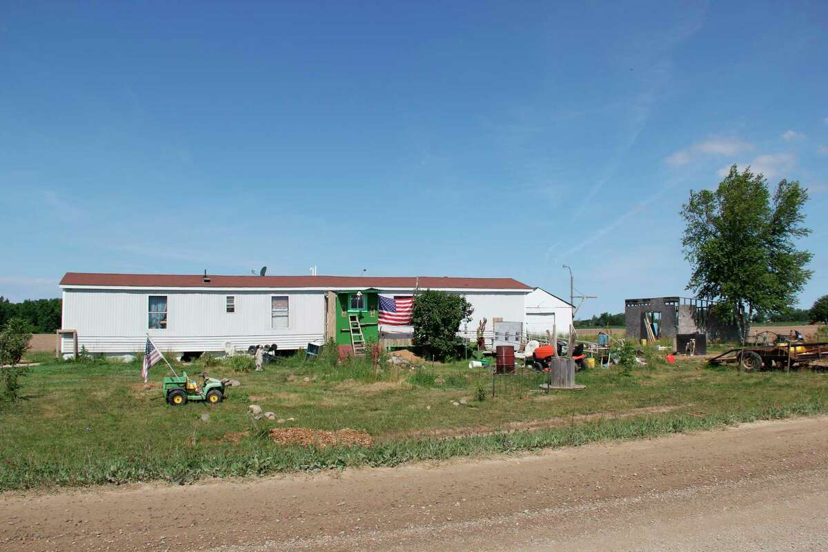 The Huron County Board of Commissioners approved for demolition to go ahead on this trailer on South Thomas Road. Various county departments have been involved with this property over the years, despite the owners making efforts to continue living here. (Robert Creenan/Huron Daily Tribune)
