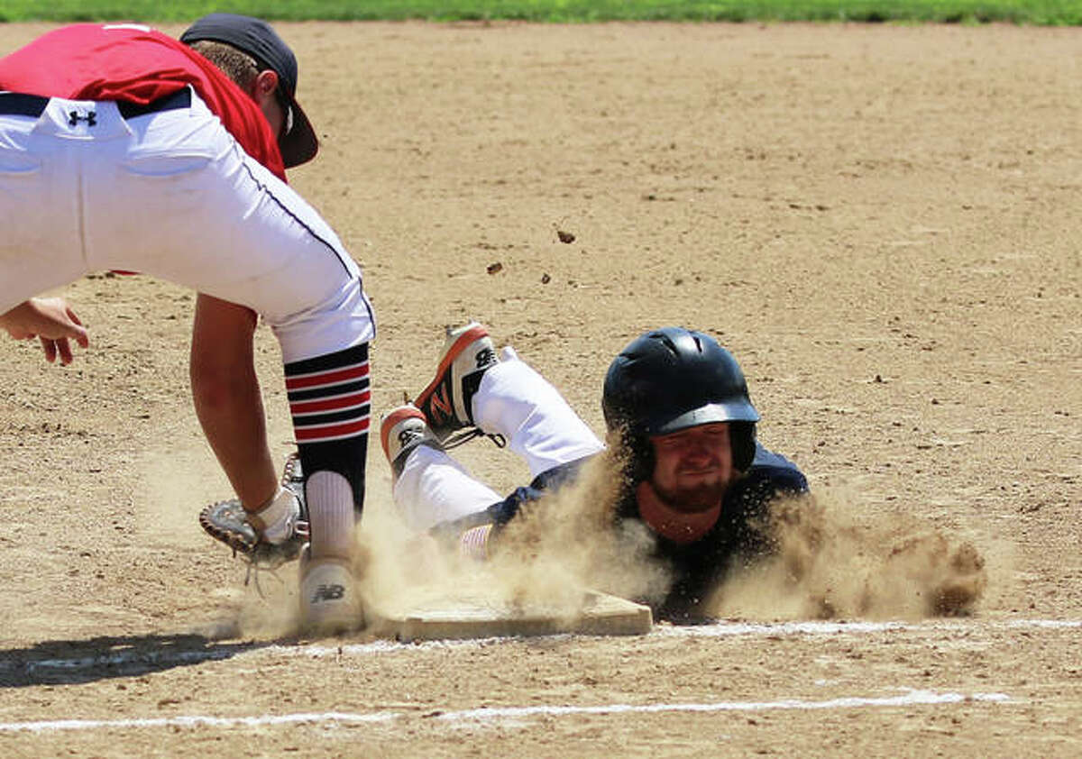 Alton Legion's Blane Lancaster (right) dives safely back to first ahead of the tag on a pickoff play last season. On Wednesday, Lancaster picked up the win pitching in relief in Post 126's senior legion baseball victory in Elsberry, Missouri.
