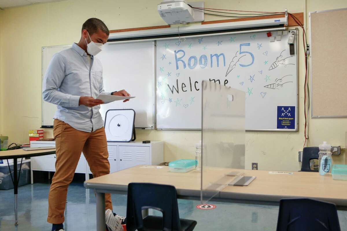 San Francisco kindergarten teacher Christopher Johnson finalizes preparing his classroom as the district preps for the first day of in-person learning in over a year on April 9.
