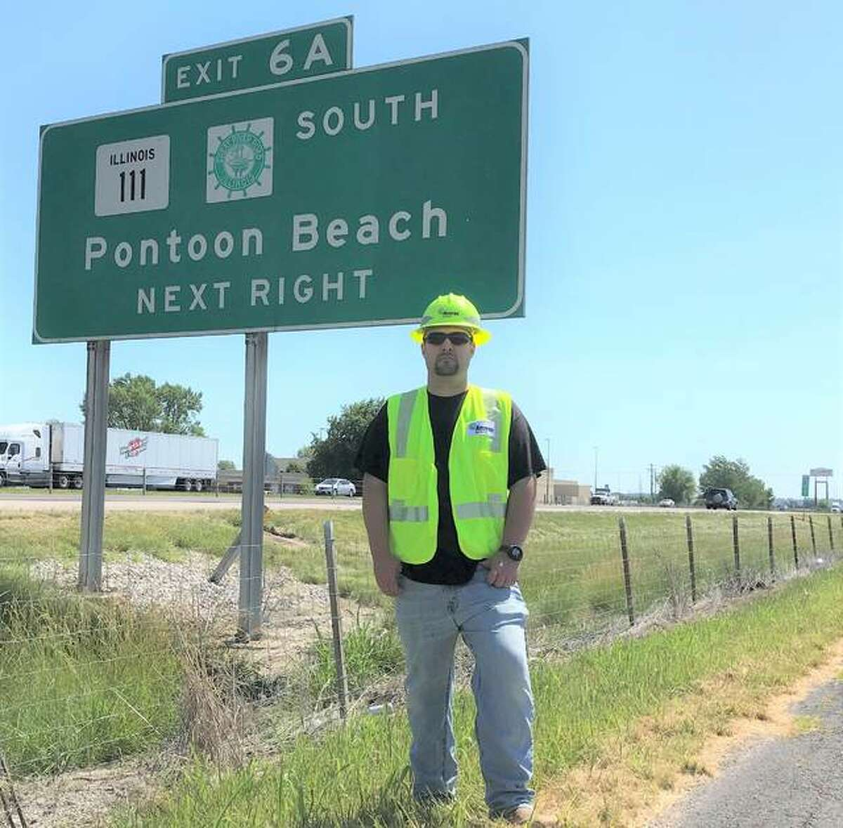Ryan Lattina of Maryville, an Ameren Illinois energy services associate, stands along the Interstate 270 frontage road where he performed a Good Samaritan act to help a motorist whose vehicle left the interstate and was submerged in a spillway.