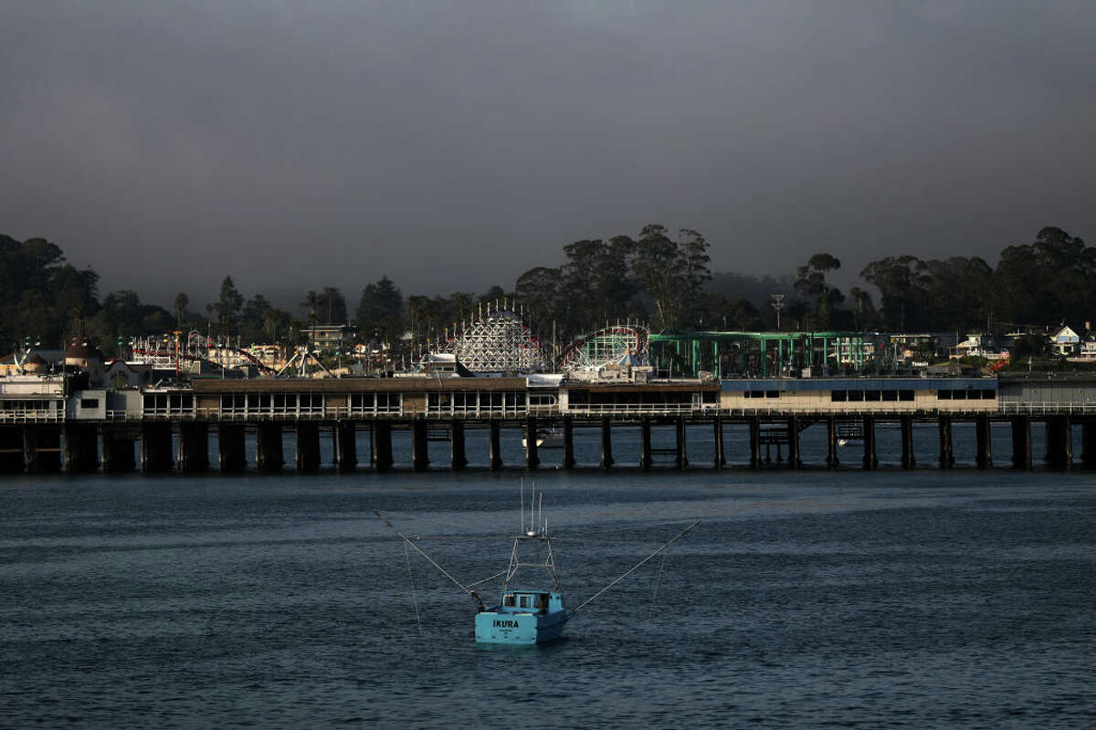 The Municipal Wharf and the Beach Boardwalk in the background on Friday, May 8, 2020, in Santa Cruz, Calif.