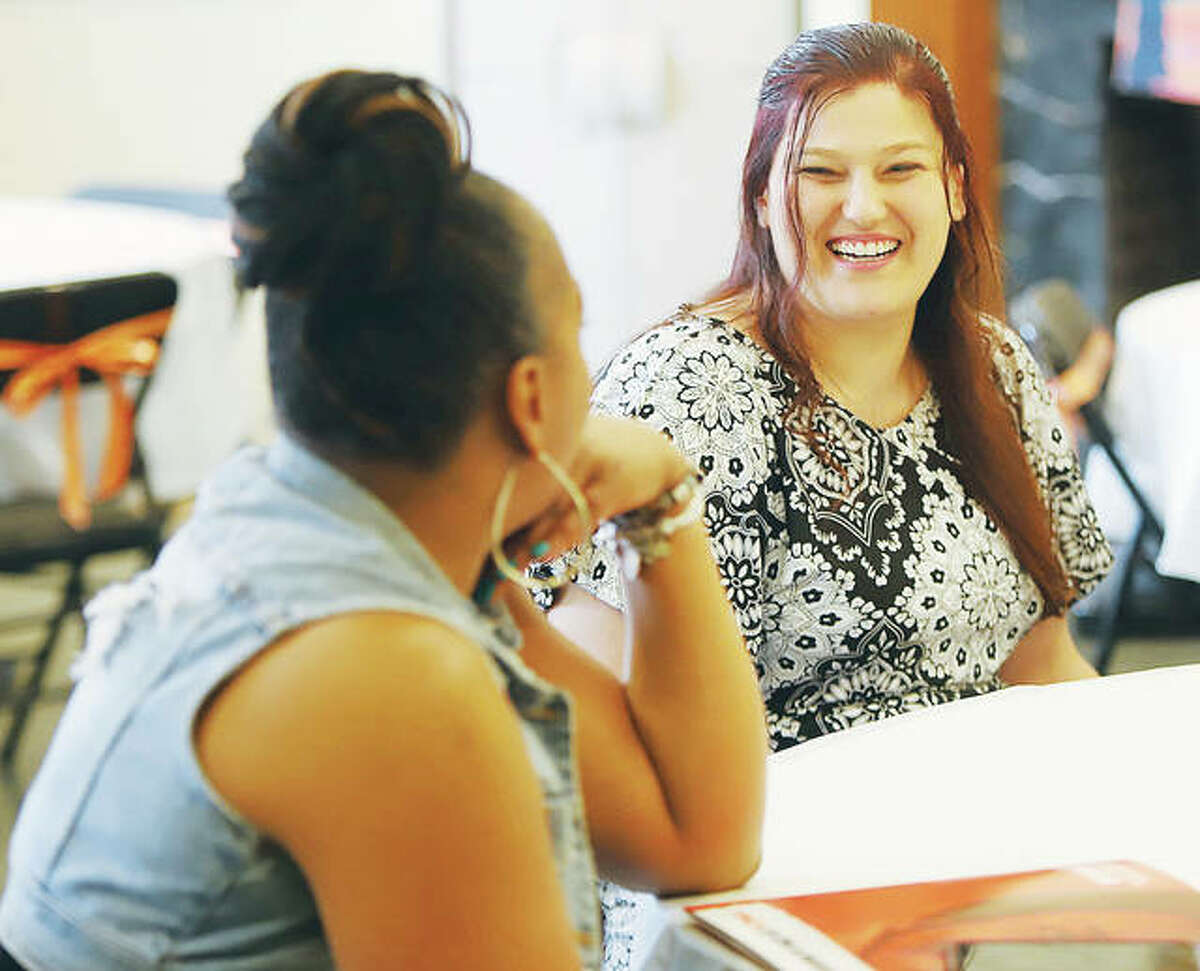 The 2021 Women of Distinction candidates gathered for a luncheon Thursday at the YWCA in Alton. Here, candidates Yvonne Campbell, left, and Savanna Bishop, right, share a laugh during the event.