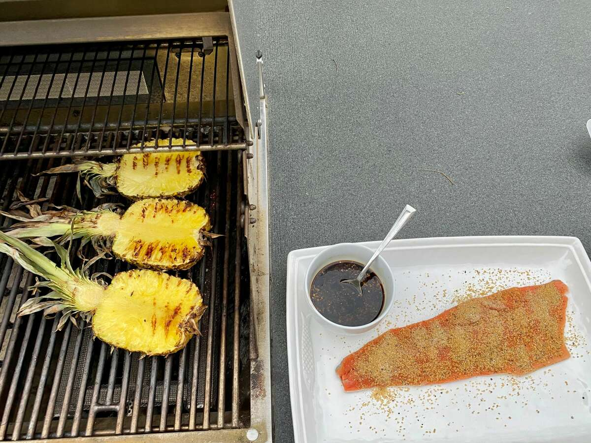 Searing the pineapple before laying the salmon atop it allows the natural sugars to caramelize and sweeten both the pineapple and the salmon. (Susie Davidson Powell/for the Times Union.)
