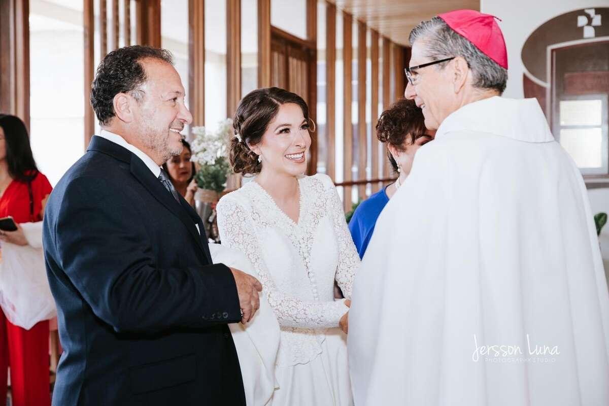 Mariana talking with Archbishop Gustavo Garcia-Siller.