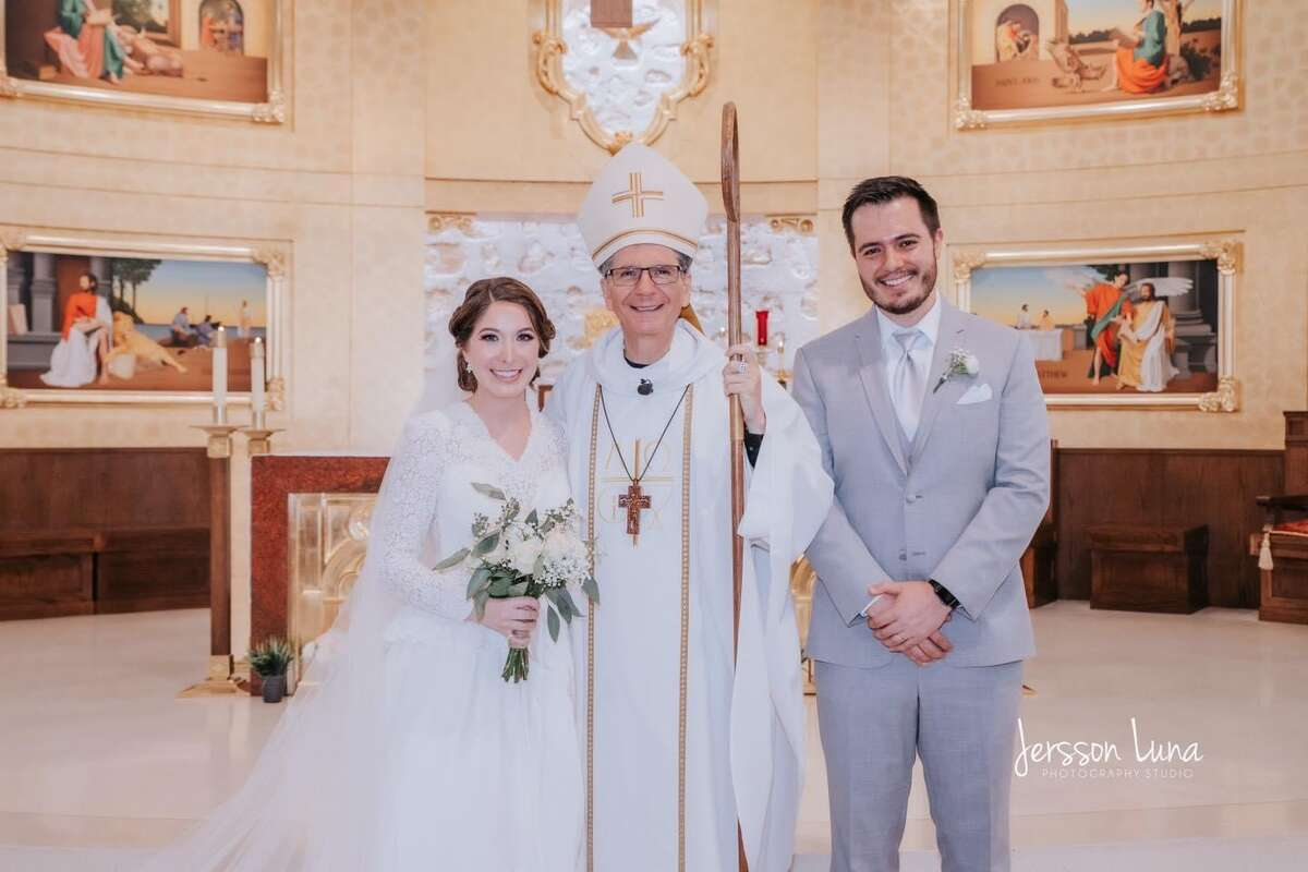 Mariana and her husband with Archbishop Gustavo Garcia-Siller.