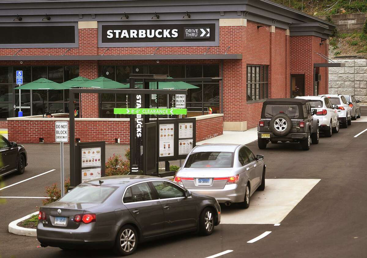 Cars are lined up at the new Starbucks Drive-Thru at 965 White Plains Road in Trumbull, Conn. on Monday, May 3, 2021.