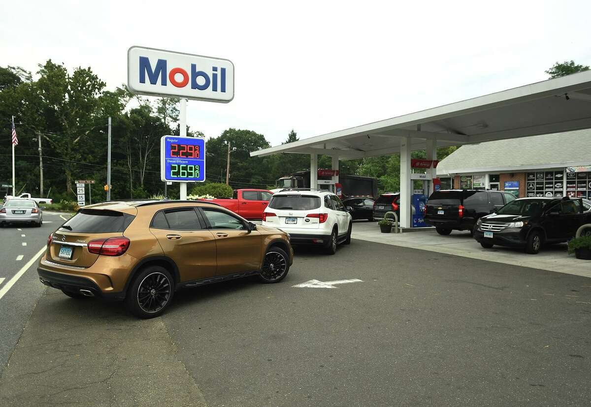 Cars line up for gas at the Mobil station in Trumbull on White Plains Road on Thursday, August 6, 2020.