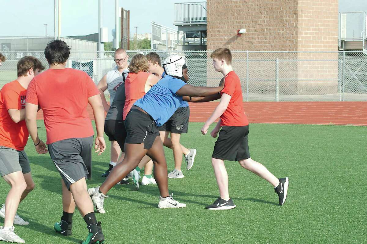 Linemen Blaine Nunn and Cooper Todd participate in a blocking drill Thursday at the Clear Falls football SWAT camp.