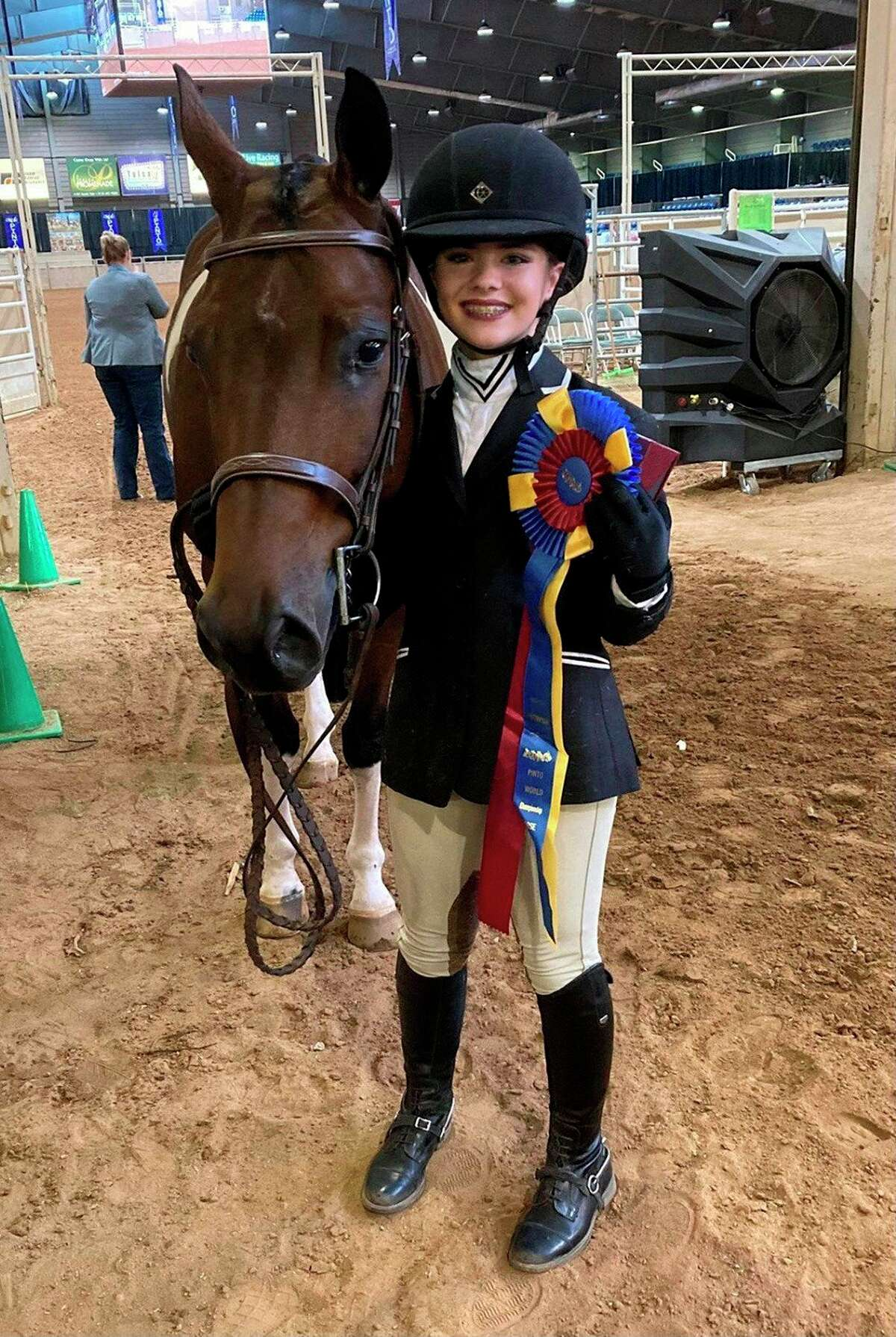 Twelve-year-old Reed City student Malley Terrynis pictured at the Pinto World Championship show in Tulsa, Oklahoma with her horse Bill Simpson. (Courtesy/Malley Terryn)