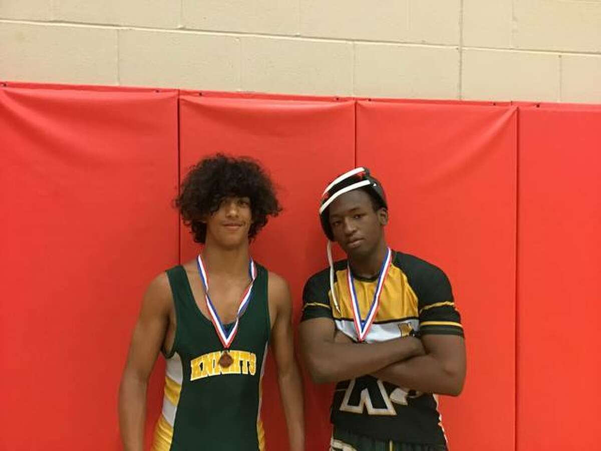 Metro-East Lutheran's Elijah Schlessinger and Chad Gray pose together after finishing fourth at the Lawrenceville Sectional and advancing to the state tournament.