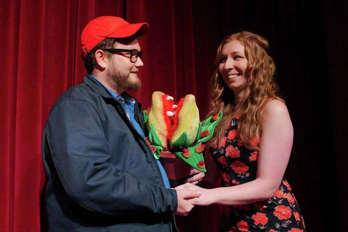 """Something green, mean and growing comes between Seymour, played by Taylor Fisher, and Audrey, played by Sarah Kelley, in Art Park Players' production of """"Little Shop of Horrors."""""""