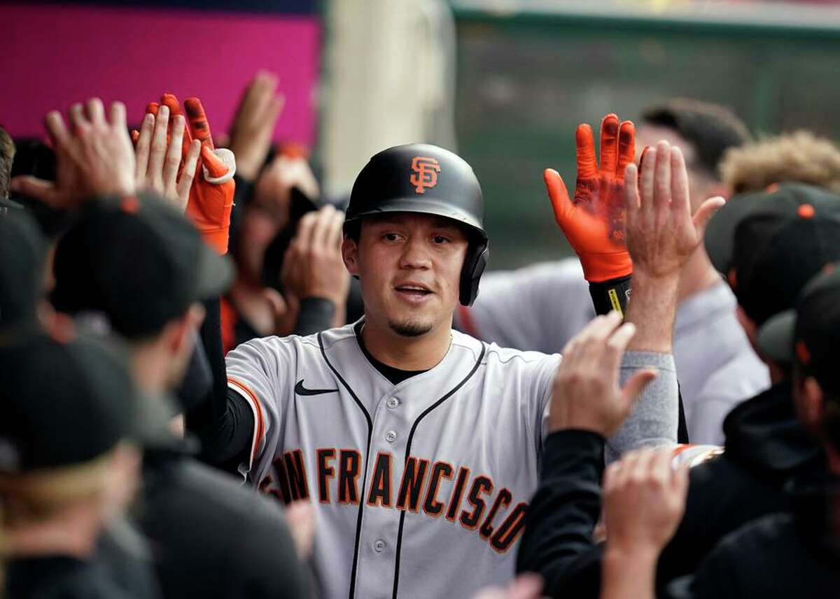 Giants utility man Wilmer Flores celebrates his two-run home run during the first inning Tuesday in Anaheim.
