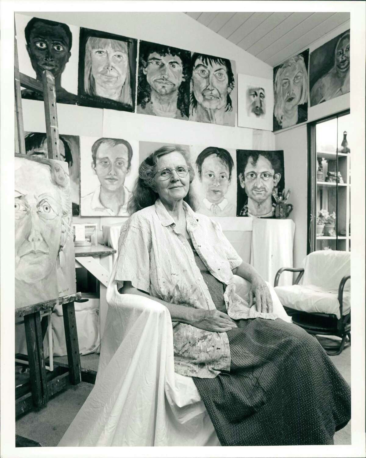 Jackie Kirk in her studio with her portraits of AIDS patients and other works, circa 199.1