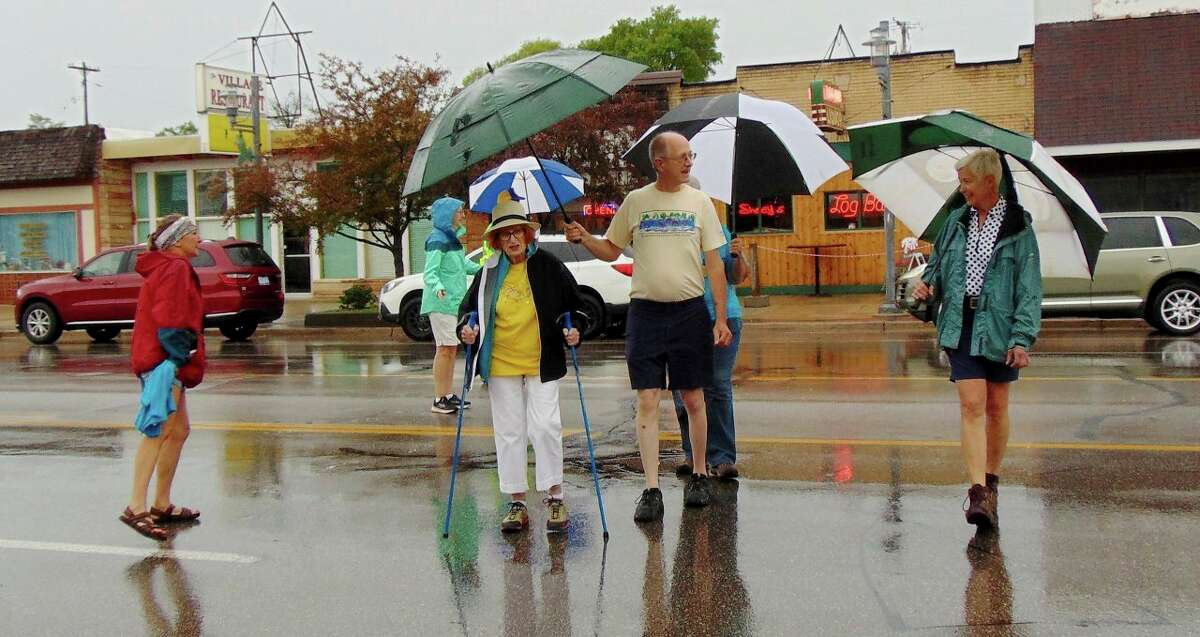Participants braved the rain showers during the 0.5K rotary event, but the skies cleared up in time for a chicken barbecue and prizes. (Star photo/Shanna Avery)