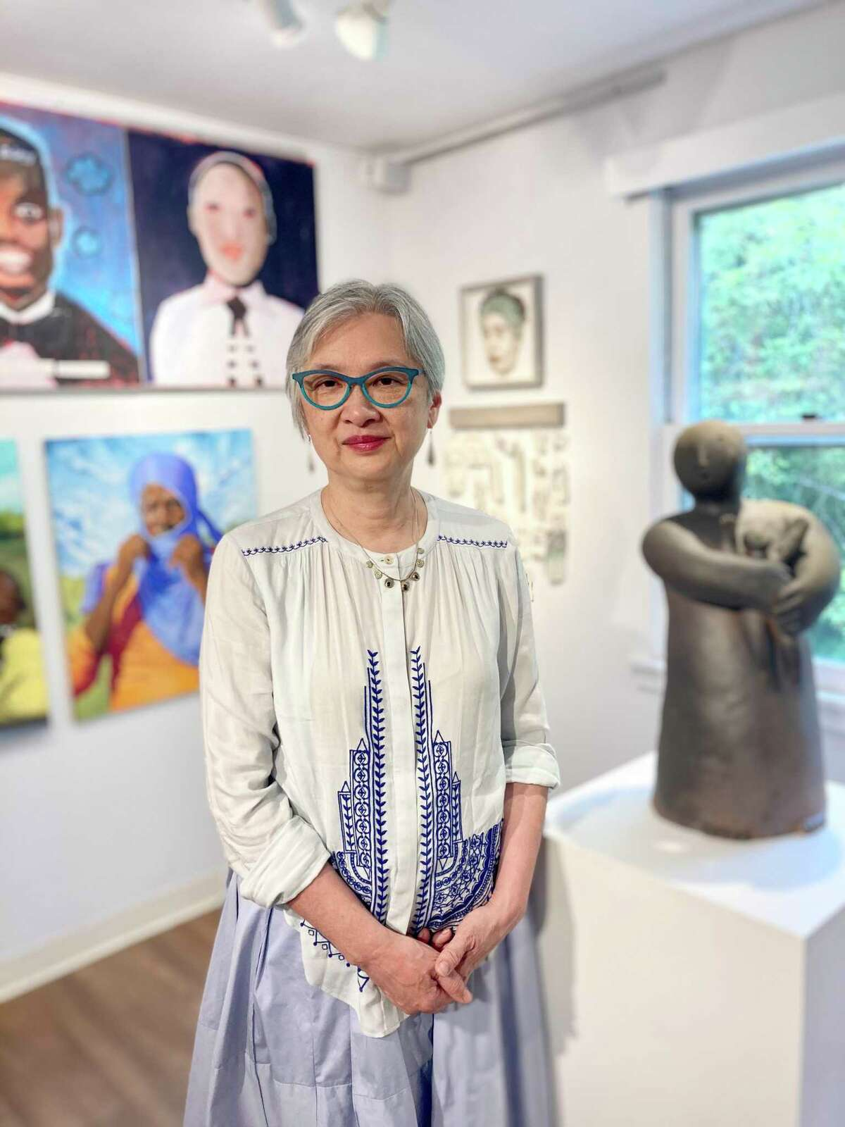 """Curator Bibiana Huang Matheis on opening day of the exhibition, """"US All"""" at the Brookfield Craft Center."""