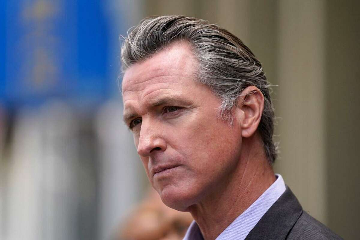 In this June 3, 2021 file photo, California Gov. Gavin Newsom listens to questions during a news conference outside a restaurant in San Francisco While governors across the country are ending all or most of their coronavirus restrictions, many of them are keeping their pandemic emergency orders in place. Those orders allow them to restrict public gatherings and businesses, mandate masks, sidestep normal purchasing rules, tap into federal money and deploy National Guard troops to administer vaccines.
