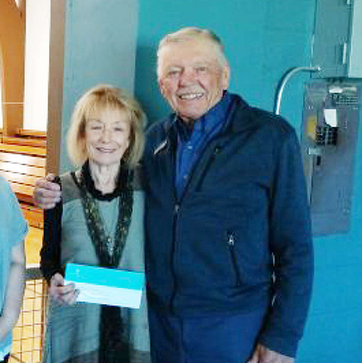 Linda Karle-Nelson and Tom Nelson, of PFLAG are shown in this photo after receiving a check from the Youth Advisory Council of the Manistee Community Foundation in 2019.