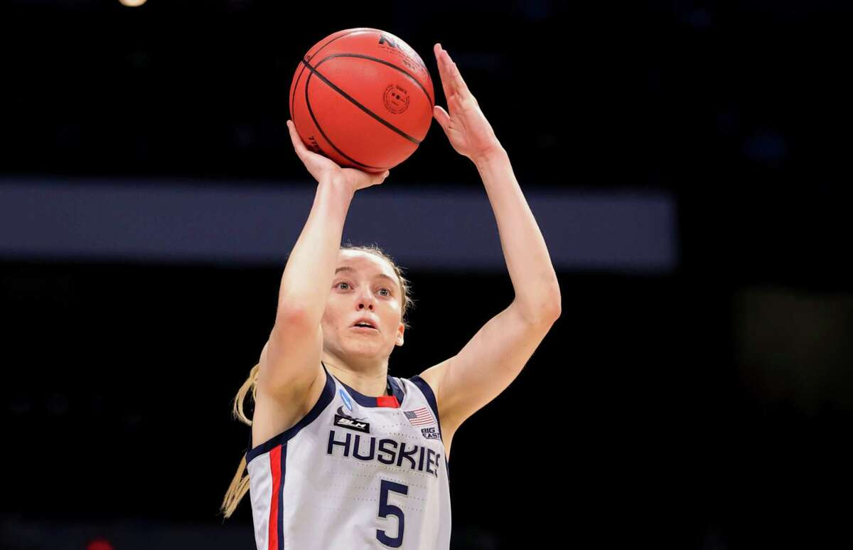 The NCAA faced criticism this year for offering nicer facilities to the men's teams than the women's teams in the championship tournament. Although it's not a Title IX issue (because the NCAA isn't an educational institution), the disparity brought attention to the ongoing inequality between men's and women's sports. Here, Paige Bueckers of the UConn Huskies shoots during the first half against the Baylor Lady Bears in the Elite Eight round.