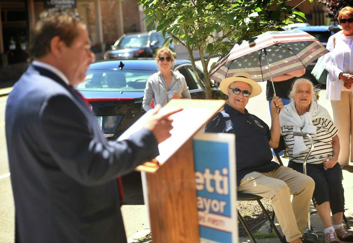 With his brother, Joseph, and 95-year-old mother, Lillian, in attendance, Ansonia Mayor David Cassetti announces his plans to run for re-election on Main Street in Ansonia, Conn. on Thursday, June 24, 2021.