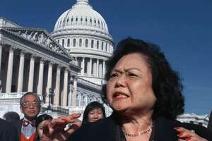 ** RETRANSMISSION TO ADD DATELINE ** FILE ** Rep. Patsy Mink, D-Hawaii, meets reporters on Capitol Hill in this  Nov. 5, 1997 file photo.  Mink, who had been hospitalized for nearly a month with viral pneumonia, died Saturday, Sept. 28, 2002, at Straub Clinic and Hospital, in Honolulu, Hawaii her office said. She was 74.