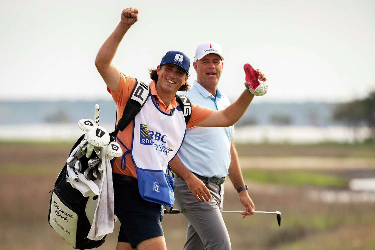 Reagan Cink raises his arms to the crowd while walking with his father Stewart Cink up the 18th fairway during the RBC Heritage in Hilton Head Island, S.C. this past April.
