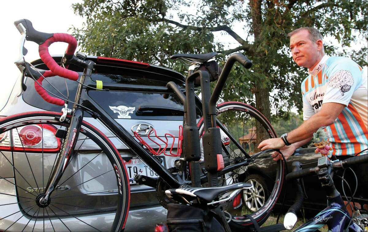 Dean Arnold, of Houston, unloads his bike before a previous Burn Your Buns Bike Race in Conroe. This year's event is set for the morning of July 4.