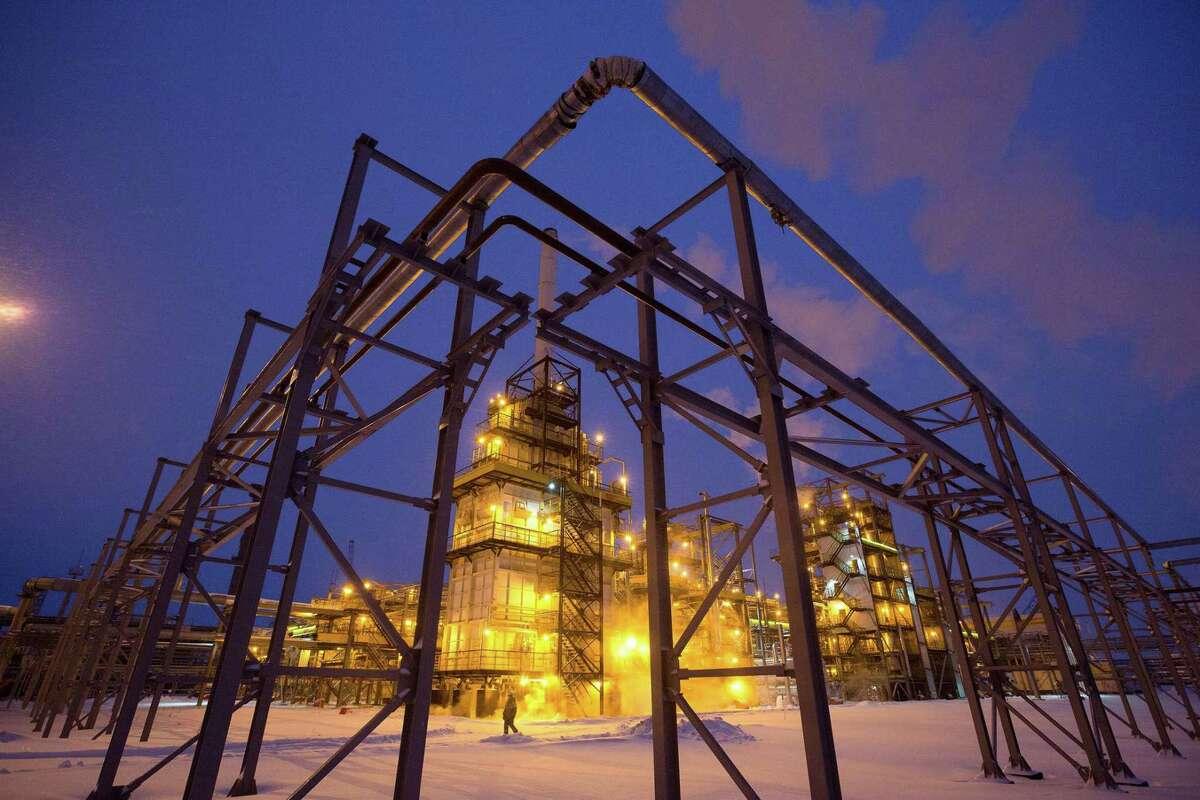 Lights illuminate the low-temperature isomerization unit at the Novokuibyshevsk oil refinery plant in Novokuibyshevsk, Samara region, Russia, on Dec. 21, 2016. MUST CREDIT: Bloomberg photo by Andrey Rudakov.