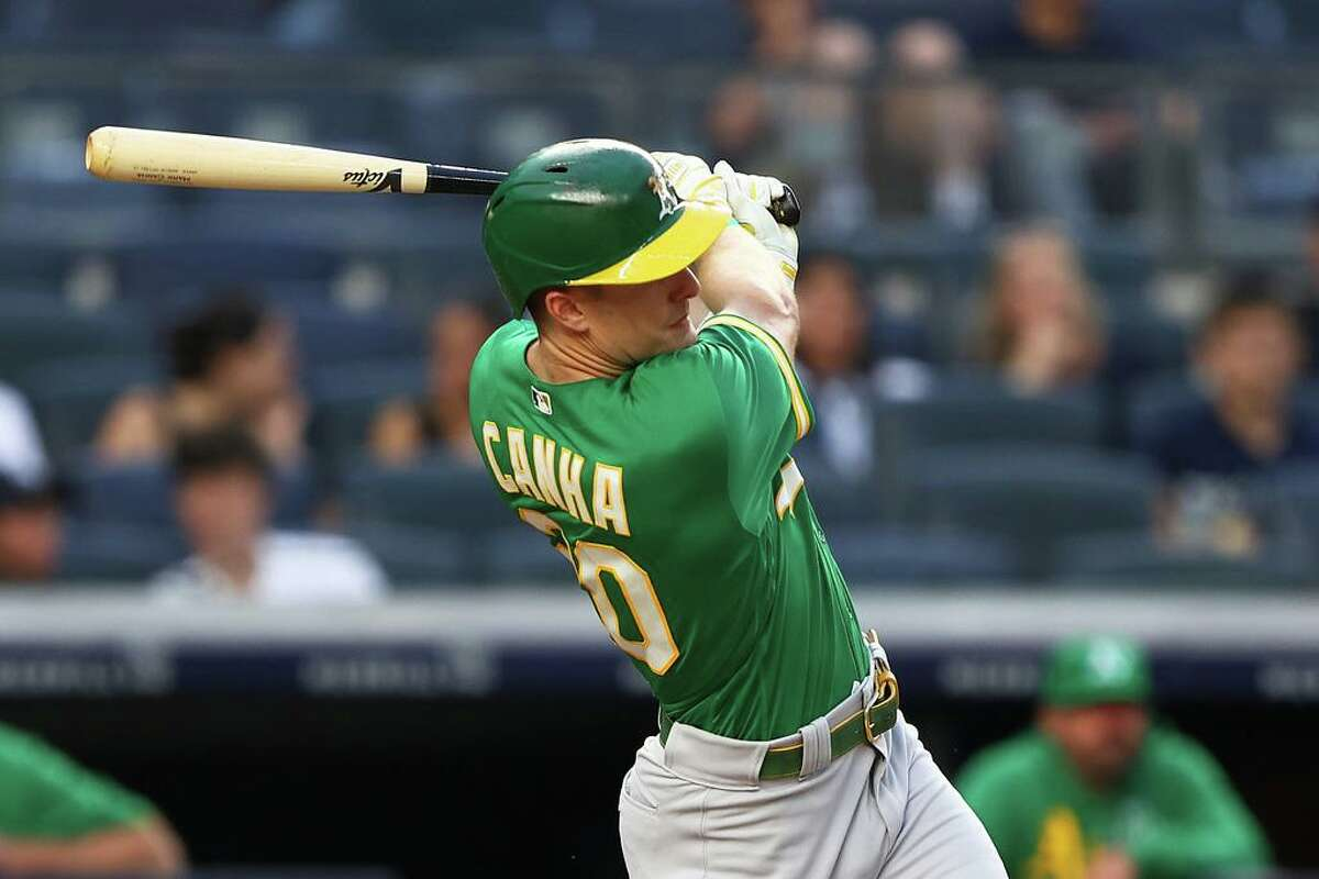 NEW YORK, NEW YORK - JUNE 18: Mark Canha #20 of the Oakland Athletics hits a RBI single in the third inning against the New York Yankees at Yankee Stadium on June 18, 2021 in New York City. (Photo by Mike Stobe/Getty Images)