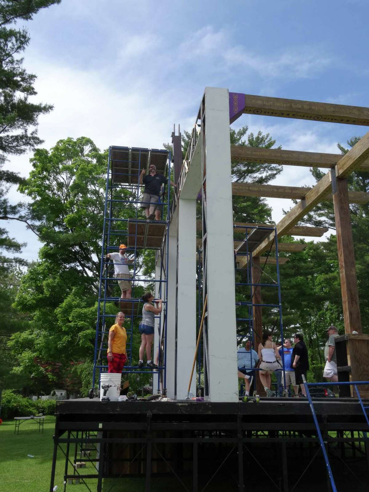Members of the Curtain Call communtiy theater company build a recreation of Shakepeare's Globe Theater every year for its Shakespeare on the Green series. This year, the company will put on the Bard's Romeo and Juliet.