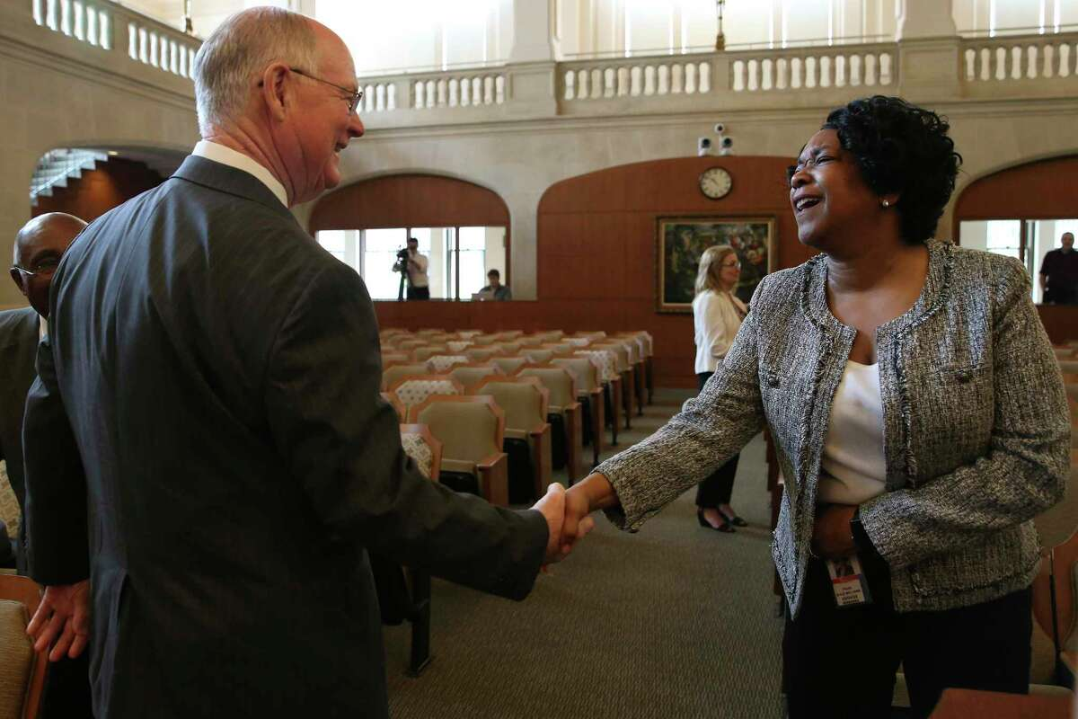 Emergency Preparedness Committee Chairman Reed Williams shakes hands with CPS Energy President and CEO Paula Gold-Williams before the chairman presents the results of a report on the February storm to the San Antonio City Council, Thursday, June 24, 2021.